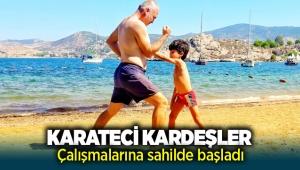 Foçalı karateci kardeşler çalışmalara sahilde başladı